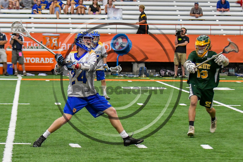 Cazenovia Lakers Cole Willard (24) winding up for a shot at the LaFayette Lancers net in Section III Boys Class C Lacrosse Championship action at the Carrier Dome in Syracuse, New York on Saturday, May 28, 2016.  Cazenovia won 11-9.