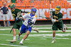 Cazenovia Lakers Dylan Hahn (6) protects the ball from LaFayette Lancers defenders in Section III Boys Class C Lacrosse Championship action at the Carrier Dome in Syracuse, New York on Saturday, May 28, 2016.  Cazenovia won 11-9.