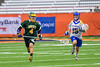 LaFayette Lancers Emerson Shenandoah (4) running away from Cazenovia Lakers Jake Stowell (15) in Section III Boys Class C Lacrosse Championship action at the Carrier Dome in Syracuse, New York on Saturday, May 28, 2016.  Cazenovia won 11-9.