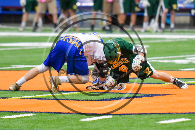 LaFayette Lancers Josh Palin (6) face off with Cazenovia Lakers Brice Basic (1) to start the Section III Boys Class C Lacrosse Championship game at the Carrier Dome in Syracuse, New York on Saturday, May 28, 2016.  Cazenovia won 11-9.
