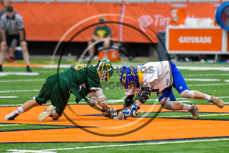 LaFayette Lancers Josh Palin (6) facing off against Cazenovia Lakers Brice Basic (1) in Section III Boys Class C Lacrosse Championship action at the Carrier Dome in Syracuse, New York on Saturday, May 28, 2016.  Cazenovia won 11-9.