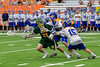 LaFayette Lancers goalie Brendan Whalen (21) keeping the ball from Cazenovia Lakers defenders Jake Stowell (15) and Derek White (31) in Section III Boys Class C Lacrosse Championship action at the Carrier Dome in Syracuse, New York on Saturday, May 28, 2016.  Cazenovia won 11-9.