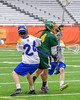 LaFayette Lancers Emerson Shenandoah (4) splits two Cazenovia Lakers defenders in Section III Boys Class C Lacrosse Championship action at the Carrier Dome in Syracuse, New York on Saturday, May 28, 2016.  Cazenovia won 11-9.