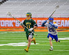 LaFayette Lancers Alex Porcello (11) running with the ball against as Cazenovia Lakers Jake Lewis (26) pursues in Section III Boys Class C Lacrosse Championship action at the Carrier Dome in Syracuse, New York on Saturday, May 28, 2016.  Cazenovia won 11-9.