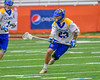 Cazenovia Lakers TJ Connellan (23) with the ball against  the LaFayette Lancers in Section III Boys Class C Lacrosse Championship action at the Carrier Dome in Syracuse, New York on Saturday, May 28, 2016.  Cazenovia won 11-9.