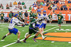 LaFayette Lancers Emerson Shenandoah (4) running with the ball against past Cazenovia Lakers defenders in Section III Boys Class C Lacrosse Championship action at the Carrier Dome in Syracuse, New York on Saturday, May 28, 2016.  Cazenovia won 11-9.