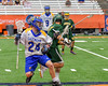 Cazenovia Lakers Cole Willard (24) protecting the ball from a LaFayette Lancers defender in Section III Boys Class C Lacrosse Championship action at the Carrier Dome in Syracuse, New York on Saturday, May 28, 2016.  Cazenovia won 11-9.