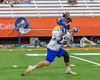 Cazenovia Lakers TJ Connellan (23) winds up for a shot at the LaFayette Lancers net in Section III Boys Class C Lacrosse Championship action at the Carrier Dome in Syracuse, New York on Saturday, May 28, 2016.  Cazenovia won 11-9.