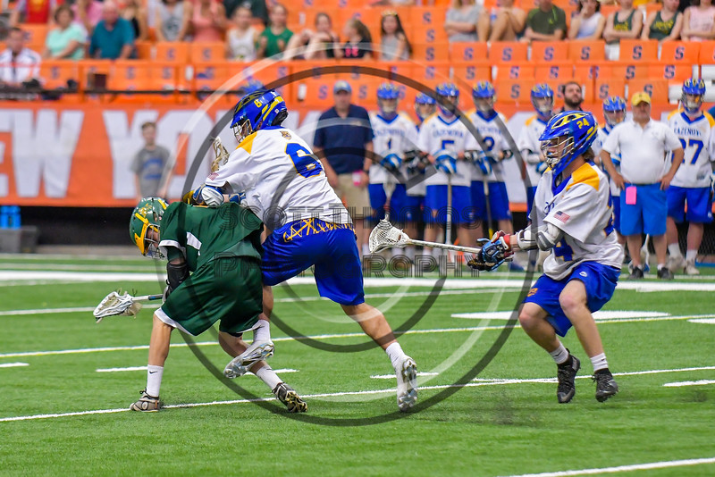 LaFayette Lancers Ian Evans (2) gets checked by Cazenovia Lakers Dylan Hahn (6) in Section III Boys Class C Lacrosse Championship action at the Carrier Dome in Syracuse, New York on Saturday, May 28, 2016.  Cazenovia won 11-9.