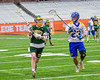LaFayette Lancers Ryan Agedal (7) running with the ball against Cazenovia Lakers TJ Connellan (23) in Section III Boys Class C Lacrosse Championship action at the Carrier Dome in Syracuse, New York on Saturday, May 28, 2016.  Cazenovia won 11-9.