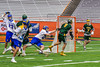 LaFayette Lancers Jordyn Marchiano (8) catches Cazenovia Lakers goalie Brendan Whalen (21) out of his net for an easy goal in Section III Boys Class C Lacrosse Championship action at the Carrier Dome in Syracuse, New York on Saturday, May 28, 2016.  Cazenovia won 11-9.