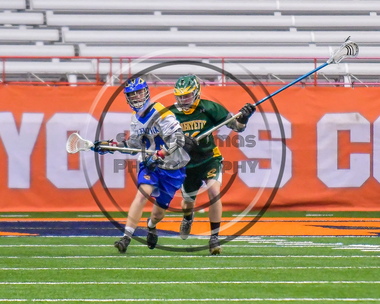 LaFayette Lancers player defending against Cazenovia Lakers Cole Willard (24) in Section III Boys Class C Lacrosse Championship action at the Carrier Dome in Syracuse, New York on Saturday, May 28, 2016.  Cazenovia won 11-9.