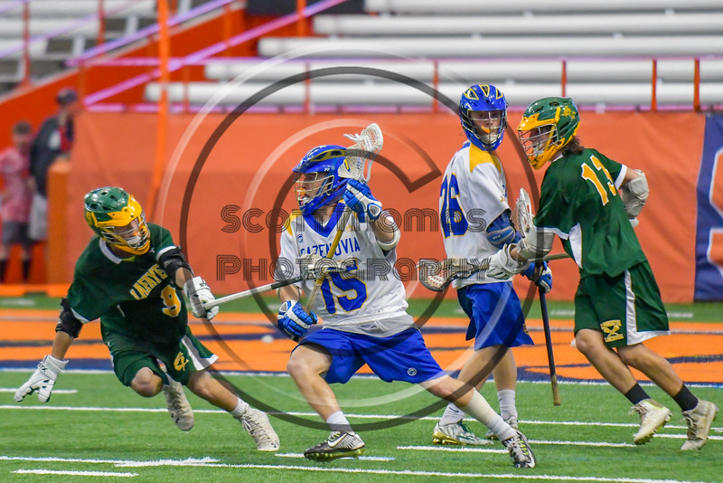 Cazenovia Lakers Jake Stowell (15) with the ball against the LaFayette Lancers in Section III Boys Class C Lacrosse Championship action at the Carrier Dome in Syracuse, New York on Saturday, May 28, 2016.  Cazenovia won 11-9.