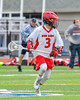 Jamesville-Dewitt Red Rams Matthew Paul (3) with the ball against the Webster Thomas Titans in NYSPHSAA Boys Class B Lacrosse Semifinals action at Bragman Stadium in Cicero, New York on Wednesday, June 8, 2016.  Jamesville-Dewitt won 13-9.