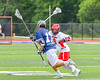 Jamesville-Dewitt Red Rams Ryan Archer (9) goes after the ball Webster Thomas Titans Ryan Canham (17) is carrying in NYSPHSAA Boys Class B Lacrosse Semifinals action at Bragman Stadium in Cicero, New York on Wednesday, June 8, 2016.  Jamesville-Dewitt won 13-9.