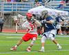 Jamesville-Dewitt Red Rams Griffin Cook (31) gets checked by Webster Thomas Titans Nick Thompson (6) in NYSPHSAA Boys Class B Lacrosse Semifinals action at Bragman Stadium in Cicero, New York on Wednesday, June 8, 2016.  Jamesville-Dewitt won 13-9.