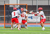 Jamesville-Dewitt Red Rams goalie Dylan Fleischman (22) stares down a shot by a Webster Thomas Titans player in NYSPHSAA Boys Class B Lacrosse Semifinals action at Bragman Stadium in Cicero, New York on Wednesday, June 8, 2016.  Jamesville-Dewitt won 13-9.