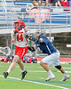 Jamesville-Dewitt Red Rams Grayson Burns (14) winds up for a shot past Webster Thomas Titans Joe Vasile (3) in NYSPHSAA Boys Class B Lacrosse Semifinals action at Bragman Stadium in Cicero, New York on Wednesday, June 8, 2016.  Jamesville-Dewitt won 13-9.