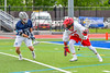 Jamesville-Dewitt Red Rams Ryan Archer (9) protecting the ball against Webster Thomas Titans Ryan Canham (17) in NYSPHSAA Boys Class B Lacrosse Semifinals action at Bragman Stadium in Cicero, New York on Wednesday, June 8, 2016.  Jamesville-Dewitt won 13-9.