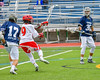 Jamesville-Dewitt Red Rams Ryan Archer (9) shoots and scores agianst the Webster Thomas Titans in NYSPHSAA Boys Class B Lacrosse Semifinals action at Bragman Stadium in Cicero, New York on Wednesday, June 8, 2016.  Jamesville-Dewitt won 13-9.
