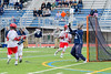 Webster Thomas Titans goalie Matt Yonko (32) makes a save against the Jamesville-Dewitt Red Rams in NYSPHSAA Boys Class B Lacrosse Semifinals action at Bragman Stadium in Cicero, New York on Wednesday, June 8, 2016.  Jamesville-Dewitt won 13-9.