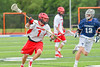 Jamesville-Dewitt Red Rams Sam Mueller (1) bringing the ball upfield aginst the Webster Thomas Titans in NYSPHSAA Boys Class B Lacrosse Semifinals action at Bragman Stadium in Cicero, New York on Wednesday, June 8, 2016.  Jamesville-Dewitt won 13-9.