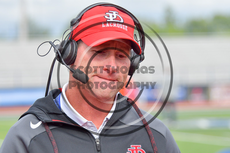 Jamesville-Dewitt Red Rams Coach Jamie Archer being interviewed after his team beat the Webster Thomas Titans in the NYSPHSAA Boys Class B Lacrosse Semifinal at Bragman Stadium in Cicero, New York on Wednesday, June 8, 2016.  Jamesville-Dewitt won 13-9.