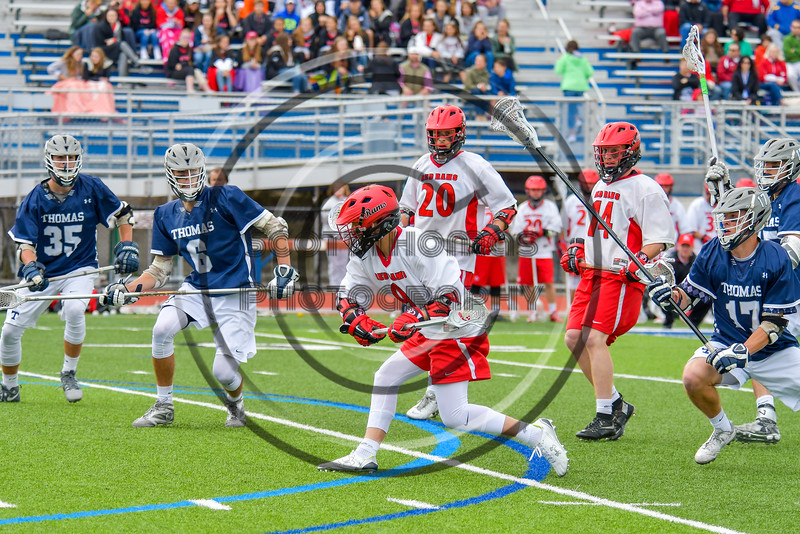 Jamesville-Dewitt Red Rams Ryan Archer (9) leans into a shot ata at the Webster Thomas Titans net in NYSPHSAA Boys Class B Lacrosse Semifinals action at Bragman Stadium in Cicero, New York on Wednesday, June 8, 2016.  Jamesville-Dewitt won 13-9.
