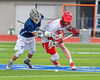 Jamesville-Dewitt Red Rams Jack Mulvihill (29) battles for a ground ball against Webster Thomas Titans Joe Luconte (13) in NYSPHSAA Boys Class B Lacrosse Semifinals action at Bragman Stadium in Cicero, New York on Wednesday, June 8, 2016.  Jamesville-Dewitt won 13-9.