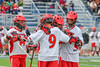 Jamesville-Dewitt Red Rams Ryan Archer (9) gets congratulated for his goal against the Webster Thomas Titans in NYSPHSAA Boys Class B Lacrosse Semifinals action at Bragman Stadium in Cicero, New York on Wednesday, June 8, 2016.  Jamesville-Dewitt won 13-9.