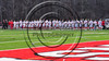 Baldwinsville Bees stand for the National Anthem before playing the Marcellus Mustangs in a Section III Boys Lacrosse game at the Pelcher-Arcaro Stadium in Baldwinsville, New York on Tuesday, March 28, 2017.