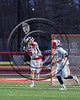 Baldwinsville Bees goalie Frank Delia (16) passing the ball upfield against the Marcellus Mustangs in Section III Boys Lacrosse action at the Pelcher-Arcaro Stadium in Baldwinsville, New York on Tuesday, March 28, 2017.  Baldwinsville won 11-5.