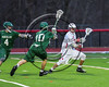 Marcellus Mustangs Gabe VanOrder (10) defending against a Baldwinsville Bees player in Section III Boys Lacrosse action at the Pelcher-Arcaro Stadium in Baldwinsville, New York on Tuesday, March 28, 2017.  Baldwinsville won 11-5.