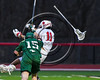 Baldwinsville Bees Cole Peters (11) has his stick knocked out of his hands by Marcellus Mustangs Kern Linder (15) in Section III Boys Lacrosse action at the Pelcher-Arcaro Stadium in Baldwinsville, New York on Tuesday, March 28, 2017.  Baldwinsville won 11-5.