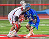 Baldwinsville Bees Michael Tangredi (26) and Cicero-North Syracuse Northstars Joel Firth (14) face-off in a Section III Boys Lacrosse game at the Pelcher-Arcaro Stadium in Baldwinsville, New York on Thursday, April 27, 2017.  Baldwinsville won 15-8.