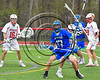 Baldwinsville Bees defenders check Cicero-North Syracuse Northstars #17 in Section III Boys Lacrosse action at the Pelcher-Arcaro Stadium in Baldwinsville, New York on Thursday, April 27, 2017.  Baldwinsville won 15-8.