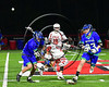 Baldwinsville Bees Jamey Natoli (25) gets knocked to the ground battling for the ball against the Cicero-North Syracuse Northstars in Section III Boys Lacrosse action at the Pelcher-Arcaro Stadium in Baldwinsville, New York on Thursday, April 27, 2017.  Baldwinsville won 15-8.