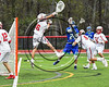 Baldwinsville Bees goalie Frank Delia (16) makes a save against Cicero-North Syracuse Northstars Josh Pickard (21) in Section III Boys Lacrosse action at the Pelcher-Arcaro Stadium in Baldwinsville, New York on Thursday, April 27, 2017.  Baldwinsville won 15-8.