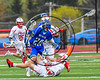 Cicero-North Syracuse Northstars Austin VanDewalker (20) with the puck against Baldwinsville Bees defenders in Section III Boys Lacrosse action at the Pelcher-Arcaro Stadium in Baldwinsville, New York on Thursday, April 27, 2017.  Baldwinsville won 15-8.