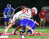 Baldwinsville Bees Cameron Slink (25) wins a face-off against the Cicero-North Syracuse Northstars in Section III Boys Lacrosse action at the Pelcher-Arcaro Stadium in Baldwinsville, New York on Thursday, April 27, 2017.  Baldwinsville won 15-8.