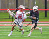 Baldwinsville Bees Cameron Slink (25) being checked by an Auburn Maroons defender in Section III Boys Lacrosse action at the Pelcher-Arcaro Stadium in Baldwinsville, New York on Saturday, April 29, 2017.  Baldwinsville won 11-6.