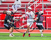 Baldwinsville Bees Peter Fiorni III (13) cradles the ball against Auburn Maroons defenders in Section III Boys Lacrosse action at the Pelcher-Arcaro Stadium in Baldwinsville, New York on Saturday, April 29, 2017.  Baldwinsville won 11-6.