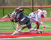 Baldwinsville Bees Cameron Slink (25) facing off against Auburn Maroons Robert Dempsey (25) in Section III Boys Lacrosse action at the Pelcher-Arcaro Stadium in Baldwinsville, New York on Saturday, April 29, 2017.  Baldwinsville won 11-6.