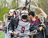 Auburn Maroons huddle up before playing the Baldwinsville Bees in Section III Boys Lacrosse action at the Pelcher-Arcaro Stadium in Baldwinsville, New York on Saturday, April 29, 2017.