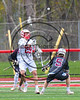 Baldwinsville Bees Kyle Pelcher (29) passing the ball over Auburn Maroons Ross Burgmaster (5) in Section III Boys Lacrosse action at the Pelcher-Arcaro Stadium in Baldwinsville, New York on Saturday, April 29, 2017.  Baldwinsville won 11-6.