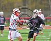 Baldwinsville Bees Brandon Mimas (21) fires the ball at the Auburn Maroons net in Section III Boys Lacrosse action at the Pelcher-Arcaro Stadium in Baldwinsville, New York on Saturday, April 29, 2017.  Baldwinsville won 11-6.