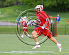 Baldwinsville Bees Kyle Pelcher (29) running with the ball against the West Genesee Wildcats in Section 3 Boys Lacrosse action at Mike Messere Field in Camillus, New York on Thursday, May 11, 2017.  West Genesee won 10-5.