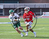 Baldwinsville Bees Cole Peters (11) is stick checked by Fayetteville-Manlius Hornets Luke Burnam (9) in Section III Class A Semifinals Boys Lacrosse action at Michael Bragman Stadium in Cicero, New York on Tuesday, May 23, 2017.  Baldwinsville won 9-8 in OT.