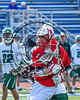 Baldwinsville Bees Michael Tangredi (26) protecting the ball from a Fayetteville-Manlius Hornets defender in Section III Class A Semifinals Boys Lacrosse action at Michael Bragman Stadium in Cicero, New York on Tuesday, May 23, 2017.  Baldwinsville won 9-8 in OT.