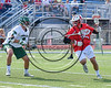 Baldwinsville Bees Michael Tangredi (26) being checked by a Fayetteville-Manlius Hornets defender in Section III Class A Semifinals Boys Lacrosse action at Michael Bragman Stadium in Cicero, New York on Tuesday, May 23, 2017.  Baldwinsville won 9-8 in OT.